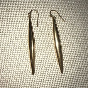 Vince Camuto gold earrings.